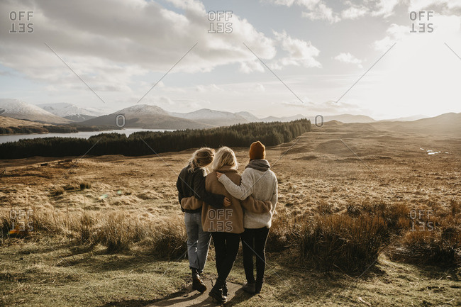 UK- Scotland- Loch Lomond and the Trossachs National Park- rear view of female friends looking at view