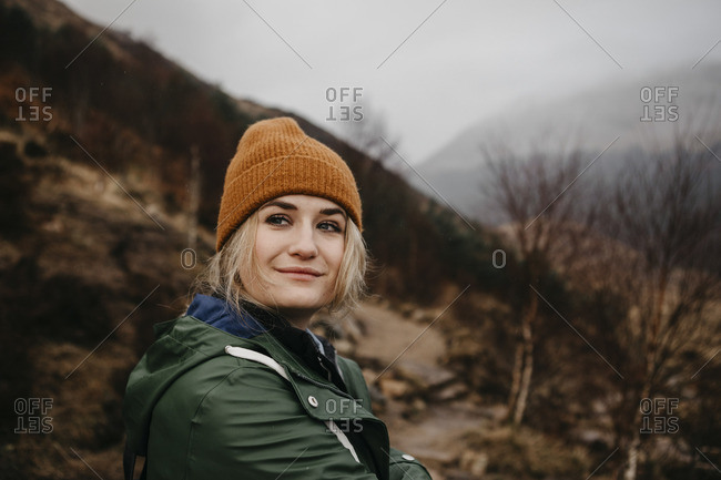 UK- Scotland- Highland- portrait of young woman in rural landscape