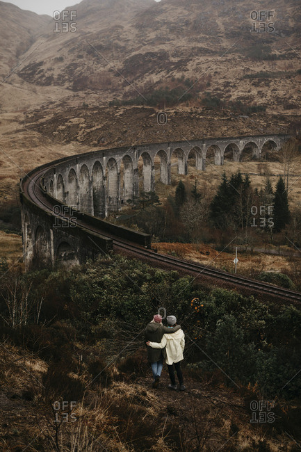 UK- Scotland- Highland- Glenfinnan Viaduct- rear view of female friends looking at view