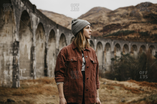 UK- Scotland- Highland- portrait of young woman at Glenfinnan Viaduct