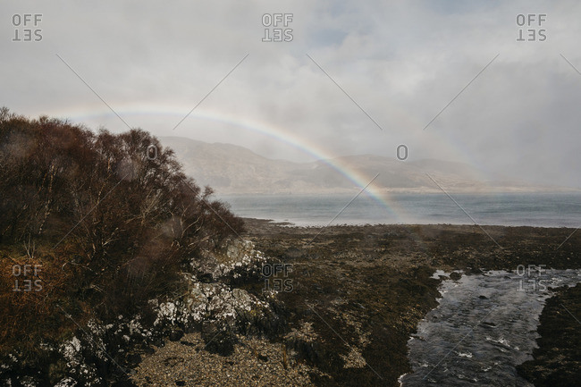UK- Scotland- Highland- rainbow above the sea