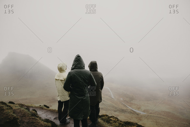 UK- Scotland- Isle of Skye- Quiraing Viewpoint- rear view of three women in foggy landscape