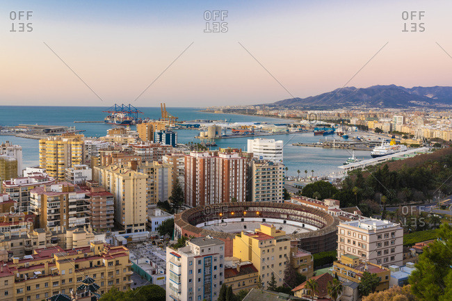 January 28,  2019: Spain- Malaga- view over the harbor and La Malagueta bullring by sunrise