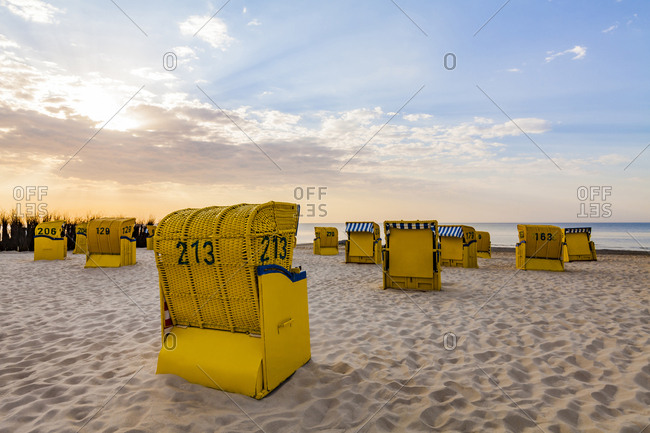 Germany- Lower Saxony- Cuxhaven- Duhnen- beach with hooded beach chairs at sunrise
