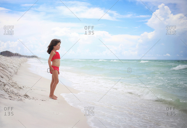 girl looking at the ocean