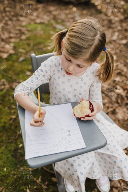 little girl sitting in a school desk