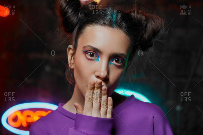 Close up portrait of a girl in cyberpunk attire