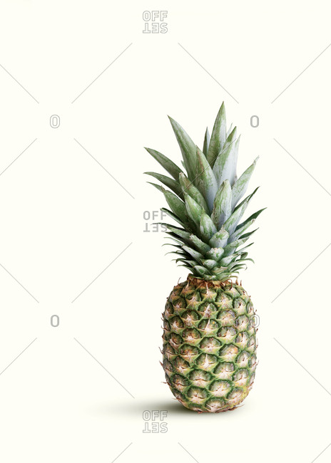 Pineapple isolated against cream colored background