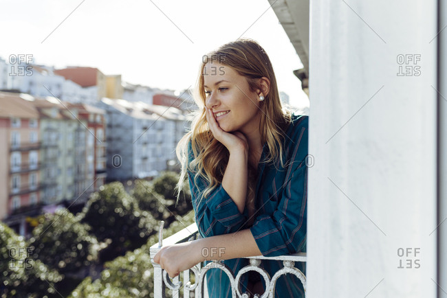 Young woman looking away on balcony