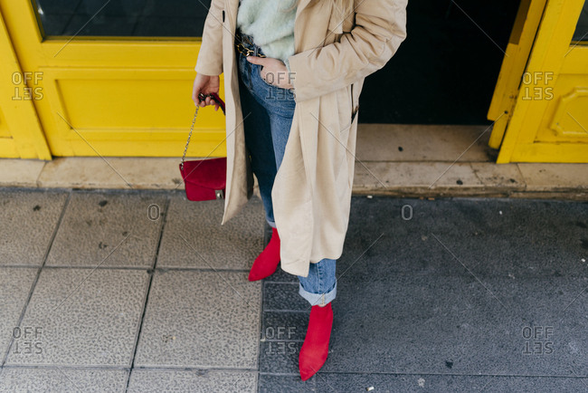 Young stylish woman standing on street