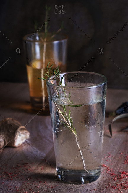 Glass of cool alcohol beverage with rosey placed on table in restaurant