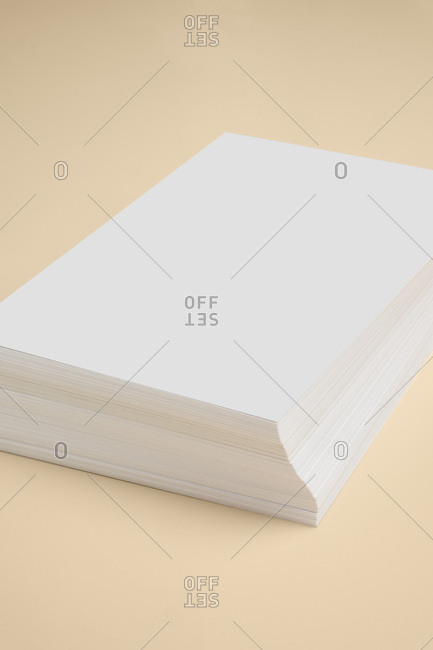 From above white business card stack template placed on yellow background