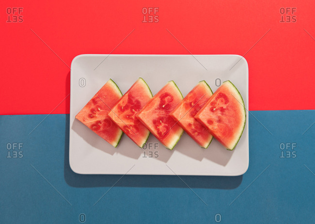 Summer juicy fruit watermelon on colorful background from above