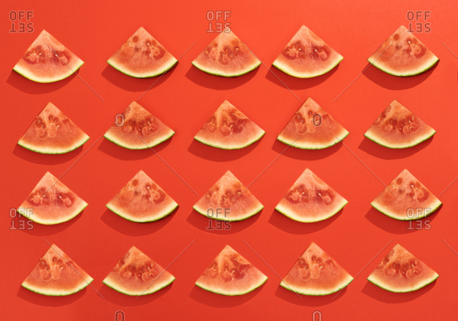 Summer juicy fruit watermelon slices in red background from above