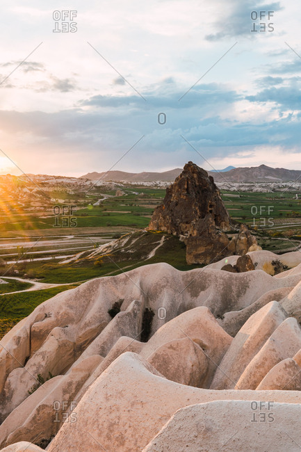 Rough stone formations located in wonderful valley on sunny day in Cappadocia, Turkey