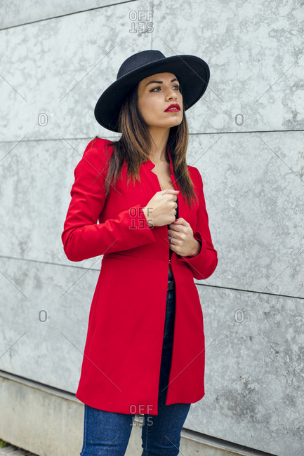 Portrait of a pretty woman with a hat and a red jacket