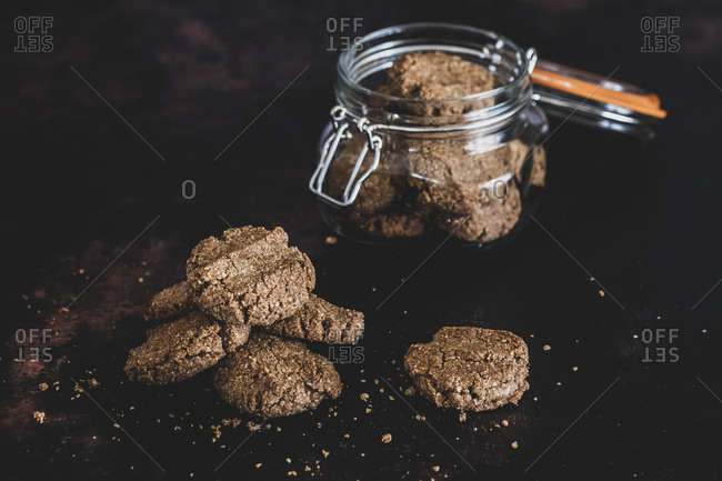 High angle close up of freshly baked chocolate cookies in a glass jar.