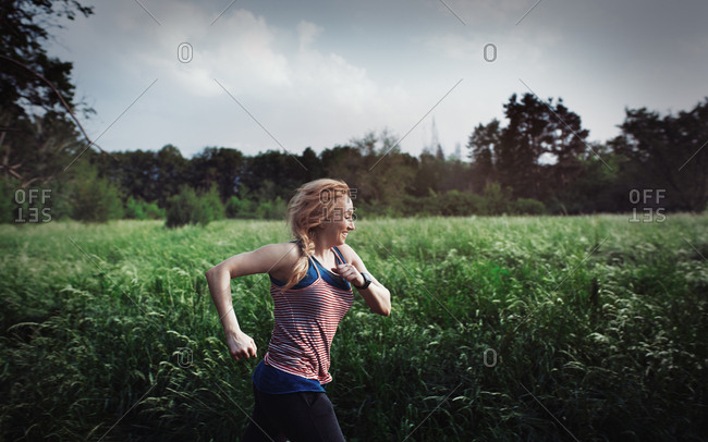 Woman running in public park at afternoon