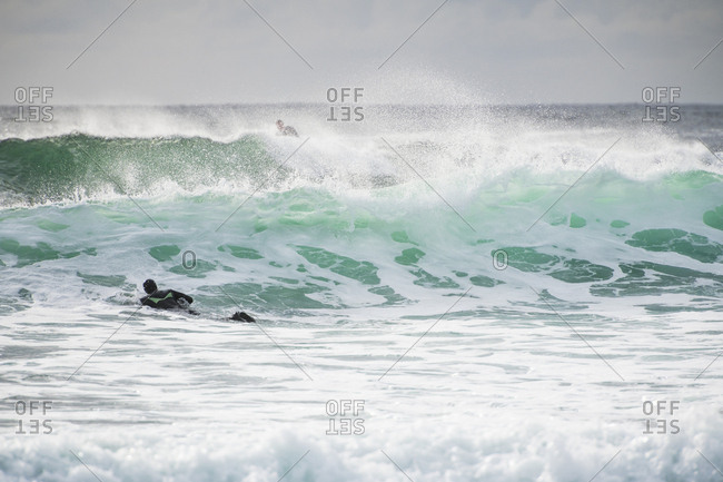 Surfer exploring coastal Ireland on a surf trip