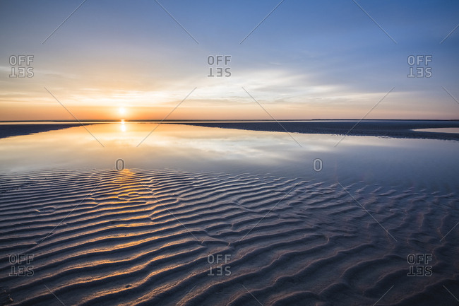 Cape cod sunset over sand flat textures