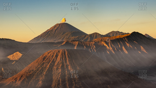 Golden hour photograph in bromo volcano while semeru erupts