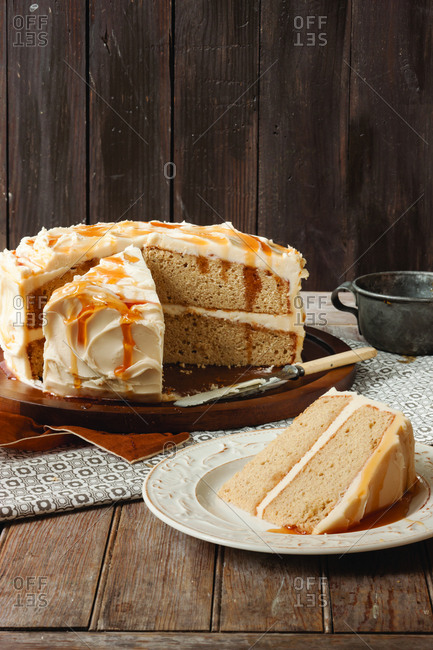Apple cider cake on wooden table against wall