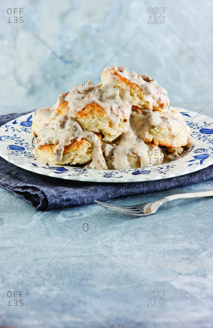 Close-up of biscuits with gravy served in plate on table at home