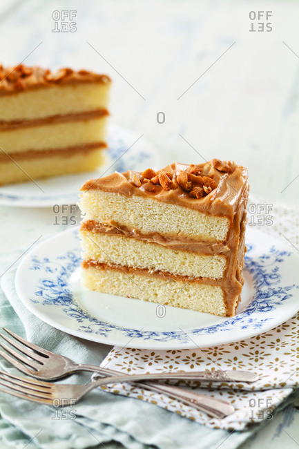 Slice of peanut butter cake served in plate on table at home