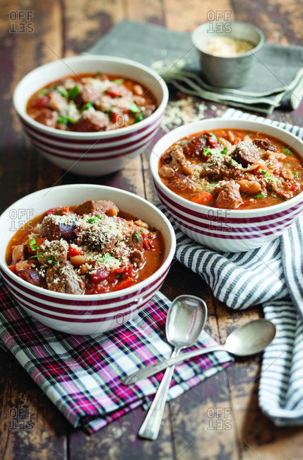 Pork cassoulet served in bowls on table at home
