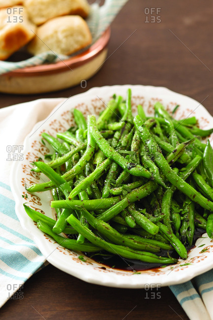 Close-up of cooked green beans in bowl on table at home