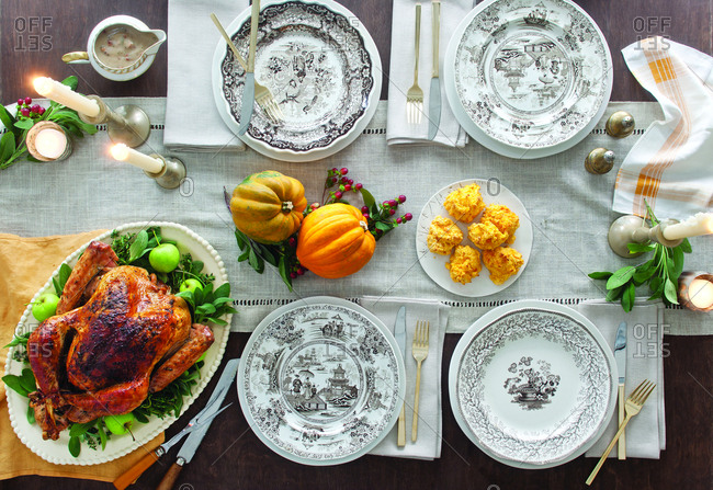 Overhead view of roasted turkey meat served on dining table at home during celebration
