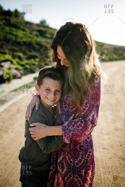 Son hugging mom in southern California