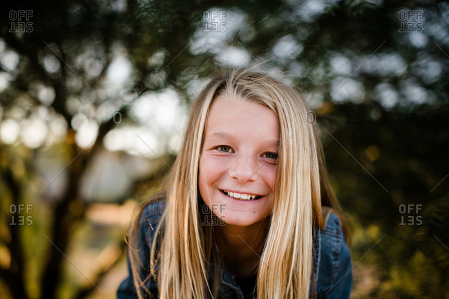 Young girl smiling at camera in southern California