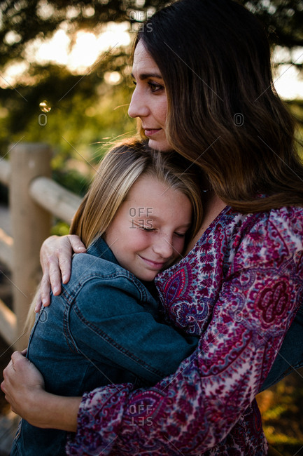 Mom and daughter hugging in southern California