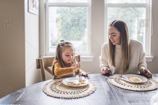 Multigenerational family eating pancakes for breakfast