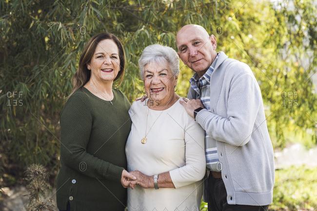 Portrait of multigenerational family standing outside