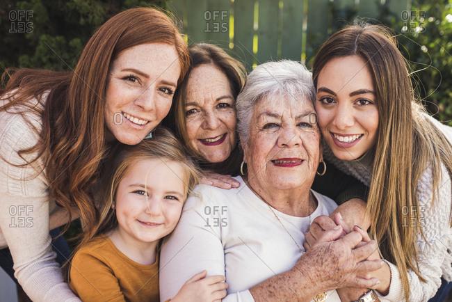 Portrait of multigenerational women close together