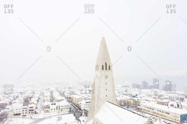 Reykjavik, Iceland - May 21, 2019: Amazing church in town in winter between fog