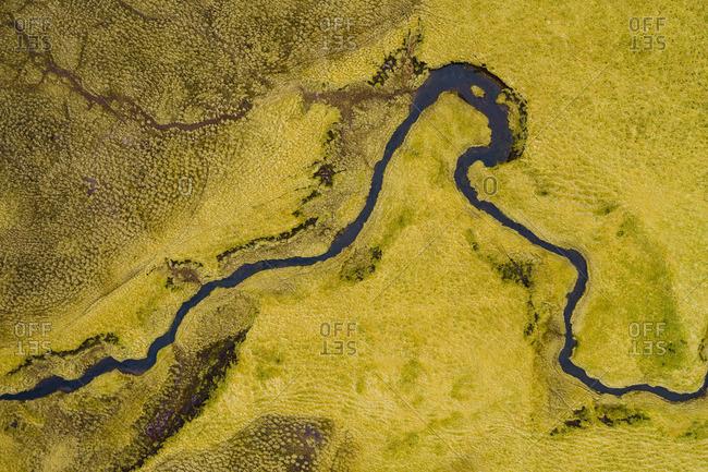River between green fields