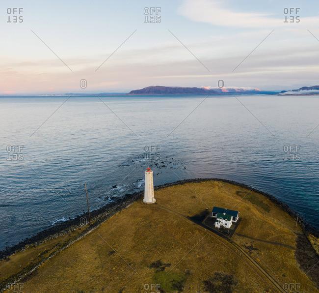 Beacon and building on coast near sea