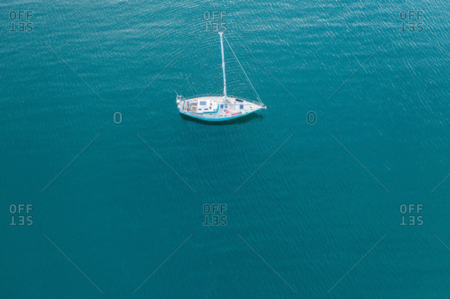 Boat floating on azure water surface