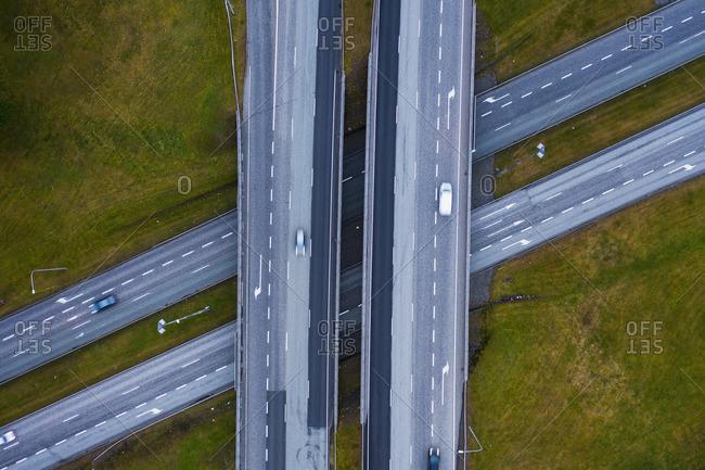 Cars on roads between green fields
