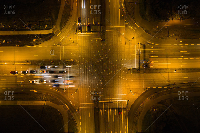 Cars waiting on crossroad in city at night