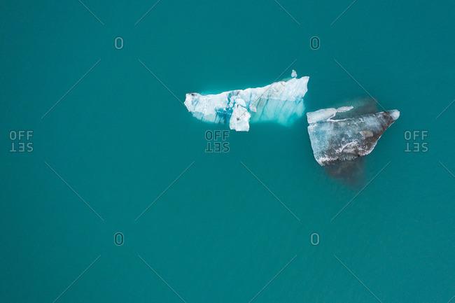 Big ice between azure water