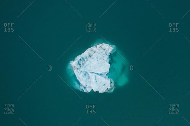 Ice between azure water