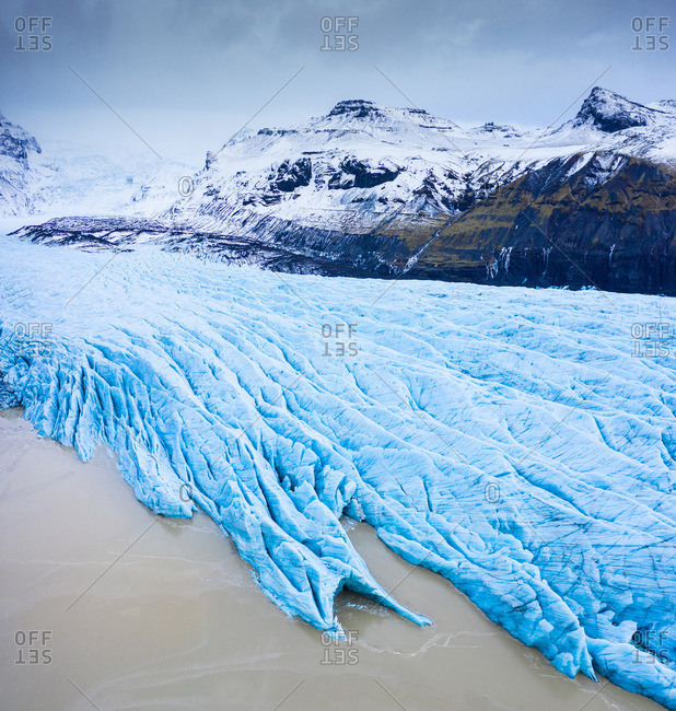 Blue ice between stone mountains
