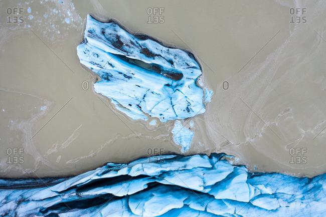 Amazing blue ice near brown land