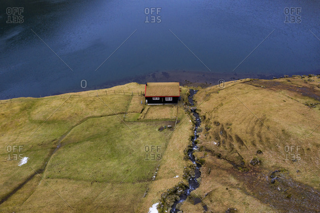 Isolated house on lagoon, saksun, streymoy, faroe islands