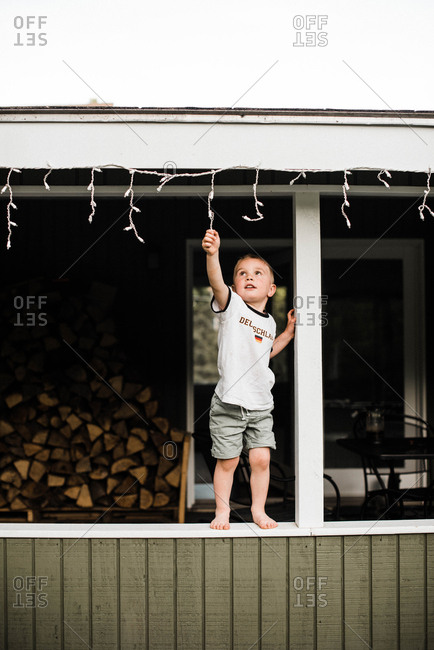 Child pulling down Christmas lights.