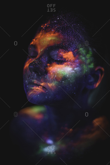 Conceptual shot of light and shine fluorescent colors young girl's fac
